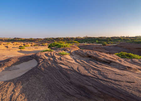 Sam Phan Bok, Ubon Ratchathani, Thailand. Dry rock reef in the Mekong River with mountain hills. Nature landscape background. Grand Canyon of Thailand.