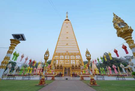 Serpent statue sculpture of chedi stupa pagoda Buddhism in Wat Phra That Nong Bua Dhammyuttika temple, Ubon Ratchathani district, Thailand.