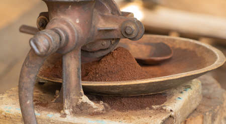 Roasting coffee beans by using traditional local coffee roast maker machine in local traditional industry factory.