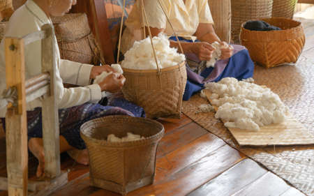 Local people hands making textile cloth fabric cotton fiber, handmade craft material fabric. Traditional people lifestyle. Embroidery.