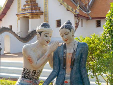 JAJA Krasip Rak or Poo Man Ya Man love romantic couple sculpture at Wat Phumin temple, Nan, Thailand. Famous tourist attraction.