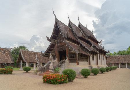 Buddha pagoda stupa. Wat Intharawat Temple or Wat Ton Kwen, Chiang Mai, Thailand. Thai buddhist temple architecture. Tourist attraction landmark.
