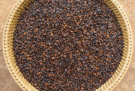 Roasted coffee bean pattern texture background. Raw food material.