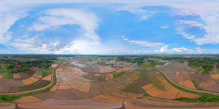 360 panorama by 180 degrees angle seamless panorama of aerial top view of paddy rice terraces with water reflection, green agricultural fields, mountain hills valley, Chiang Mai, Thailand. Nature