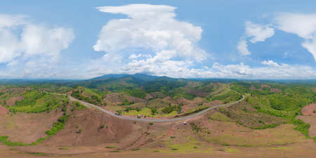 360 panorama by 180 degrees angle seamless panorama of aerial view of cars driving on curved, zigzag curve road or street on mountain hill with green natural forest trees in rural area of Nan,Thailand Banco de Imagens