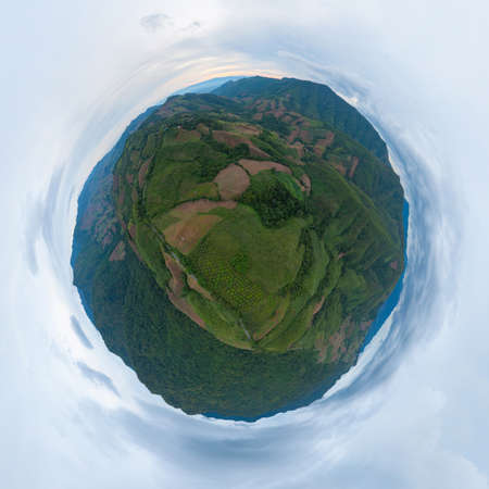 Little planet 360 degree sphere. Panorama of aerial view of forest trees and green mountain hills. Nature landscape background, Thailand.