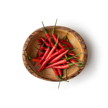 Chili peppers with sliced red chili peppers isolated on white background. Hot and spicy food. Vegetable. Seasoning ingredient.