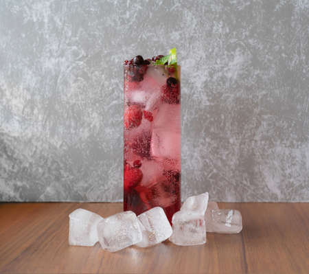 Sweet and sour fruits punch beverage with ice. Fresh cocktail juice. Smoothie drinks.