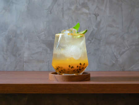 Sweet and sour passion fruit Juice beverage with ice. Fresh cocktail juice. Drinks.