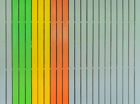 Colorful wood slats wall or lath line arrange. Flooring pattern surface texture. Close-up of interior architecture material for design decoration background.
