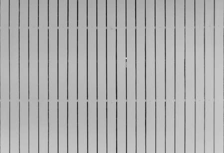 White wood slats wall or lath line arrange. Flooring pattern surface texture. Close-up of interior architecture material for design decoration background.