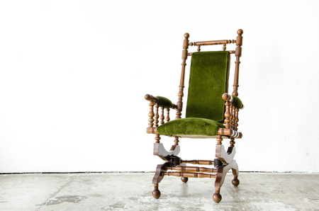Classical style rocking chair with green wool on white background Stock Photo