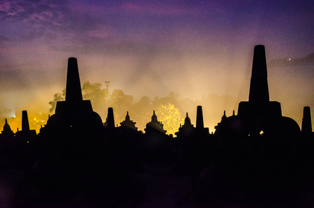 Silhouette Stupas at Borobudur in Yogyakarta,Indonesia. Stock Photo