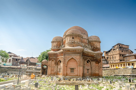 Graves surround the Tomb of Budshah, a popular tourist attraction in Srinagar, Kashmir, India. Editorial