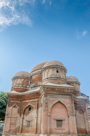 Graves surround the Tomb of Budshah, a popular tourist attraction in Srinagar, Kashmir, India. Stock Photo
