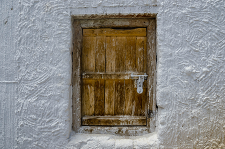 Old wooden windows of the traditional Tibetan in Ladakh, India