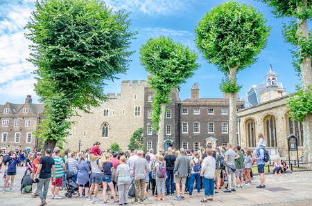LONDON, UNITED KINGDOM - July 12, 2018 : Tourists at The Tower of London, officially Her Majesty's Royal Palace and Fortress of the Tower of London, is a historic castle located on the River Thames. Redakční