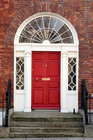 Red door on a townhouse in Dublin, Ireland photo