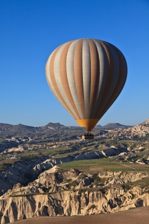 Hot air balloon at dawn in Cappadocia, Turkey photo