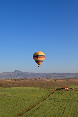 Hot air balloon drifting over Cappadocia, Turkey photo