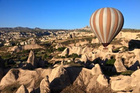 drifting: Hot air balloon drifting over fairy chimneys in Cappadocia, Turkey