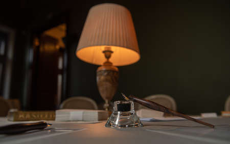 Table lamp shines on the table. Background. Standard-Bild
