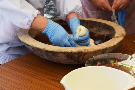 How to make Japanese traditional rice cakes (Mochi-tsuki) is many times pounding with a mallet with the steamed dlutinous rice which was in mortar.