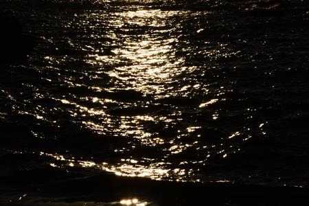 Ripples and waves crashing on rocks Reklamní fotografie