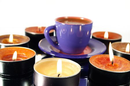 coffeetime:  cup of black hot coffee and candles