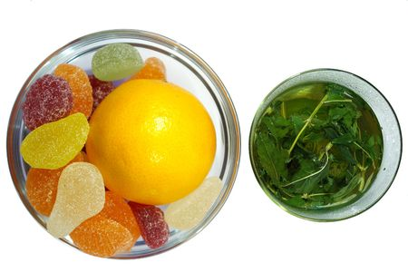 herbal  mint tea and  fruit candy on white background photo