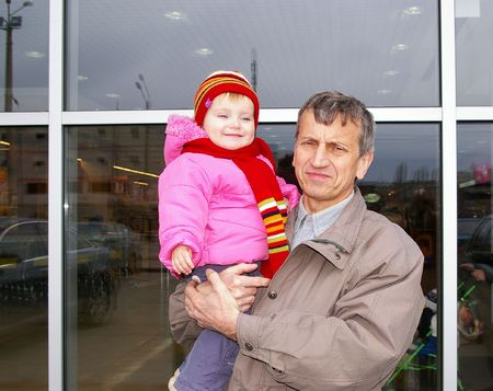 grand daughter: Grandfather and small grand daughter on a background of a supermarket
