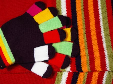 nurseries: Bright striped nurseries a scarf and gloves Stock Photo