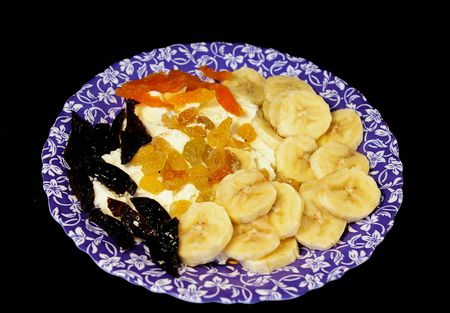 Cottage cheese with banana, dried apricots, raisin and prunes photo