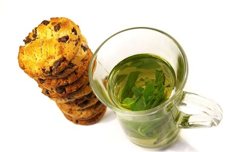 Cookies with chocolate and mint tea isolated photo