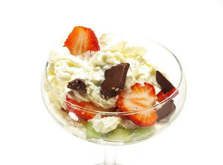 Ice cream topped with syrup, nuts, whipped cream and strawberrie. Image isolated on white. photo