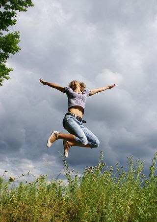 Happy young woman jumps. Sky as background Stock Photo - 3295082