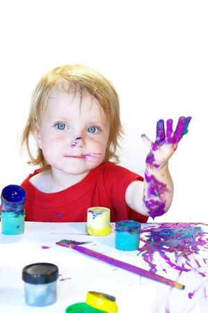 Little girl draws on a table isolated Stock Photo - 3324820