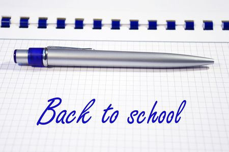 One silver pen and spiral notebook closeup photo