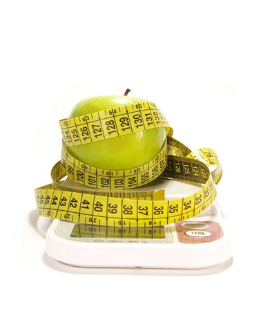 kilo: Green apple, scale and tape measure isolared Stock Photo