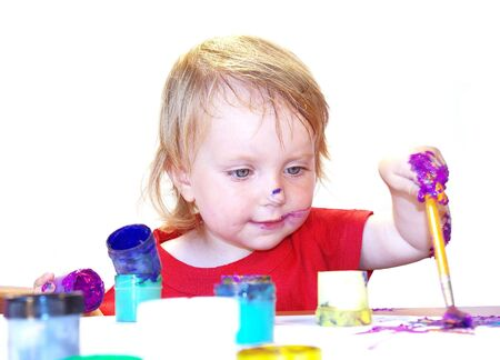 Little girl draws on a table isolated Stock Photo