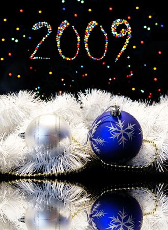 New Years card. Spheres on a black background