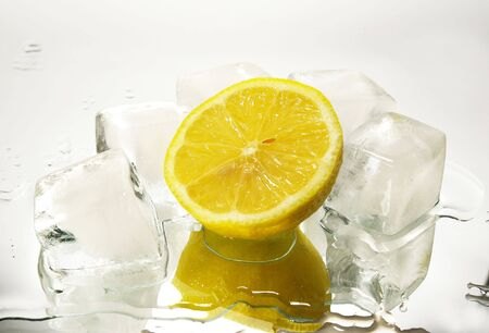 Freshness lemon and cristal cube of ice for preparation of cocktails photo