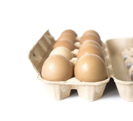 Packing of eggs isolated on a white background photo
