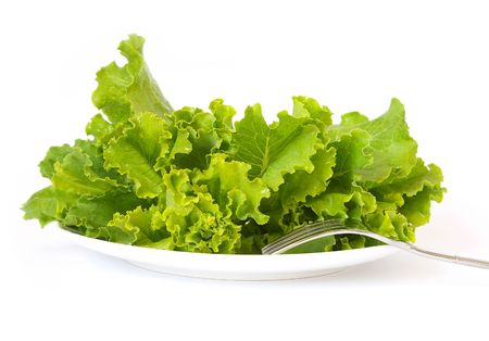 Lettuce on a white plate and a fork  Stock Photo