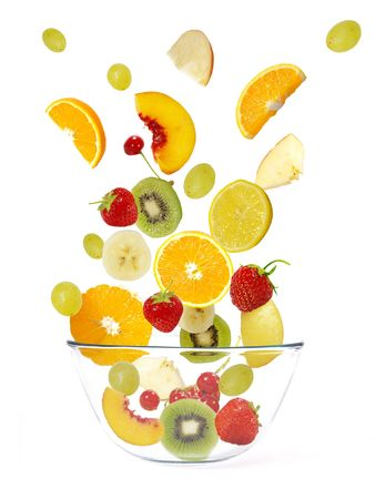 Fresh fruits salad isolated on a white background photo