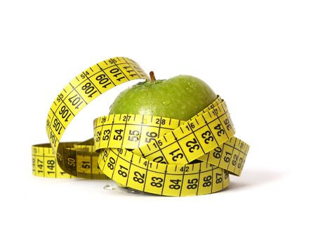 kilo: Green apple and tape measure isolared on white