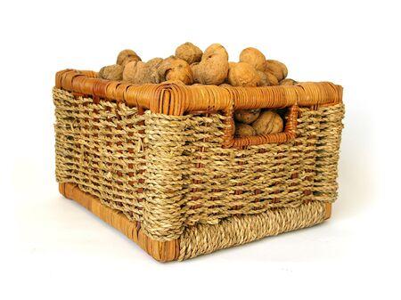 Basket of nuts isolated on white background photo