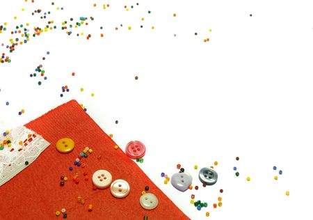 Red fabric, buttons and colorful beads as background photo