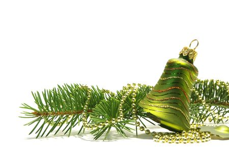 Christmas tree and bell isolated on white background photo