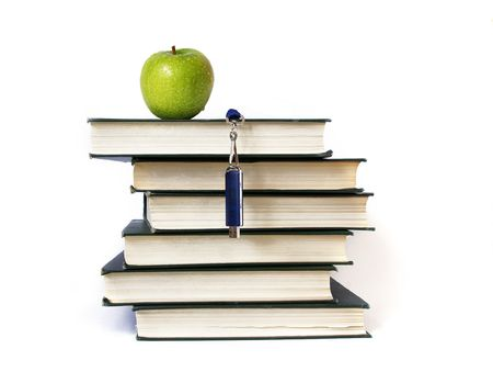 Books stack, flash memory and apple isolated on white photo